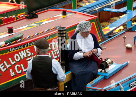 Narrow boat couple in traditional costume. Canal Cavalcade Festival, Little Venice, London, England, UK - Stock Photo