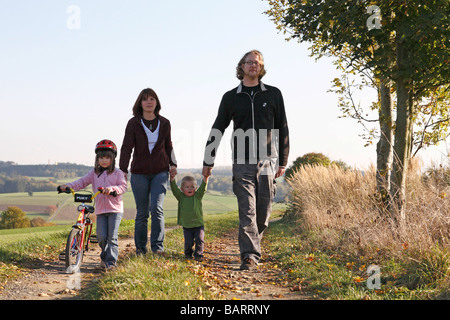 Young family taking a walk - Stock Photo