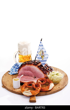 Roast Pork with Crackling, pretzels and a mug of beer on wooden board - Stock Photo