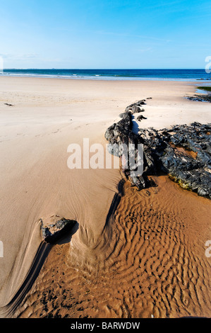 Deserted beach at Budle bay north of Bamburgh in Northumberland - Stock Photo