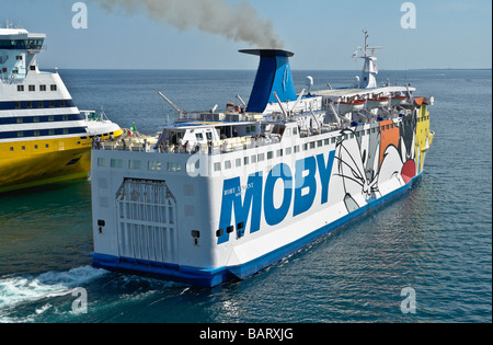 The Moby Lines car ferry Moby Vincent leaving Bastia in Corsica. Corsica Ferries' Mega Smeralda is behind. - Stock Photo