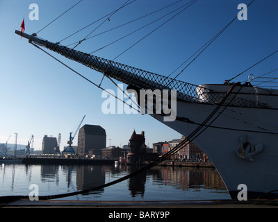 The Tall ship Gorch Fock at Stralsund harbour with the port building in the background, - Stock Photo