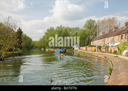 Narrowboat cruising along the River Thames at Osney in Oxford Uk - Stock Photo