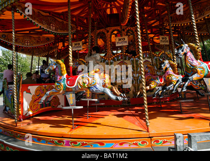 Old fashioned merry go round fair ride - Stock Photo