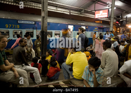 Passengers waiting for a train on the platform. Old Delhi station, also known as Northern station, Delhi. India. - Stock Photo