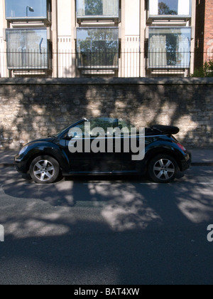 Black Volkswagen Beetle Convertable Car Parked in the Street - Stock Photo