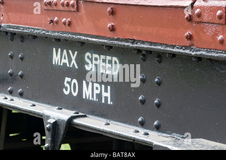 Sign on side of train advising Max Speed 50 MPH - Stock Photo