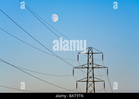 The moon rising over a pylon in Gloucestershire - Stock Photo