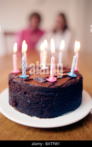 Lit candles on a cake Stock Photo, Royalty Free Image ...