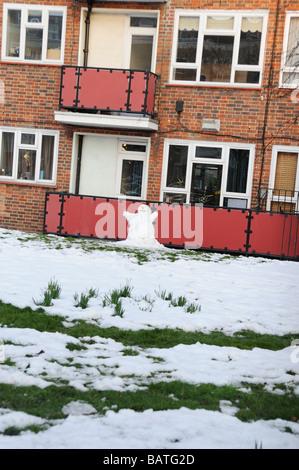 Snowman outside a block of flats Hackney,London - Stock Photo