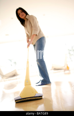 Woman mopping a floor. - Stock Photo