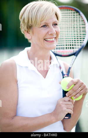 Tennis player. Woman holding atennis racquet and balls. - Stock Photo