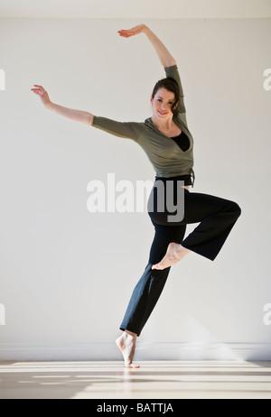 Female ballet dancer jumping, studio shot - Stock Photo