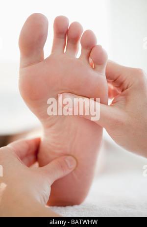 Close-up of woman having foot massage - Stock Photo