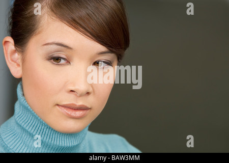 Studio portrait of a beautiful young oriental woman - Stock Photo