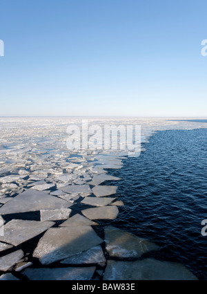 Edge of breaking and melting sea ice at Gulf of Bothnia , Baltic Sea , Finland - Stock Photo