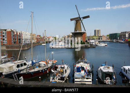 Schiedam part of Rotterdam, harbour and windmill and mooring yachts - Stock Photo