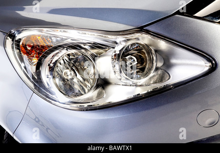 car head lights in silver - Stock Photo
