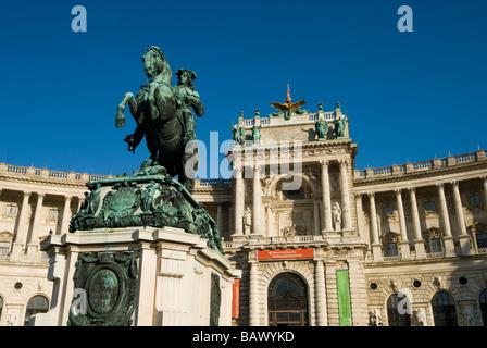 Hofburg Palace and Statue of Prince Eugene of Savoy - Stock Photo