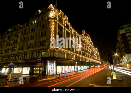 Harrods Department Store in London at Night - Stock Photo