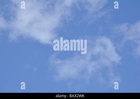 Blue Sky with Wispy Clouds ( Cirrus ) - Stock Photo