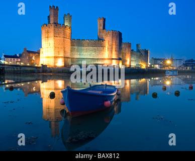 Caernarfon Castle and Estuary at Night, Caernarfon, Gwynedd, North Wales, UK - Stock Photo