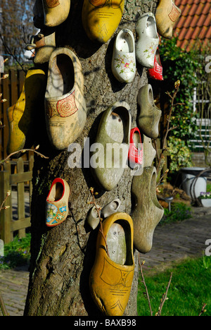 Traditional dutch wooden shoes on a tree in Marken Holland The Netherlands - Stock Photo