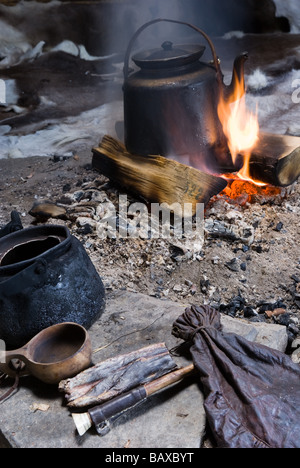 Traditonal way of making Sami coffee with reindeer meat, in a Gåhtie (traditional Sami house) in Båtsuoj Samecenter - Stock Photo