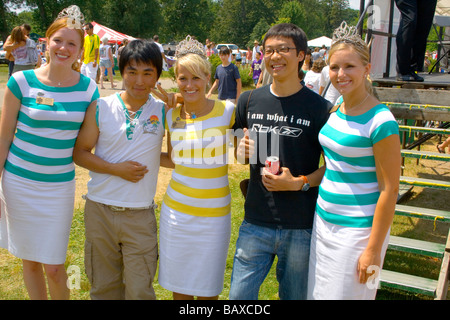 Asian visitors having fun with Aquatennial queens. Aquatennial Beach Bash Minneapolis Minnesota USA - Stock Photo