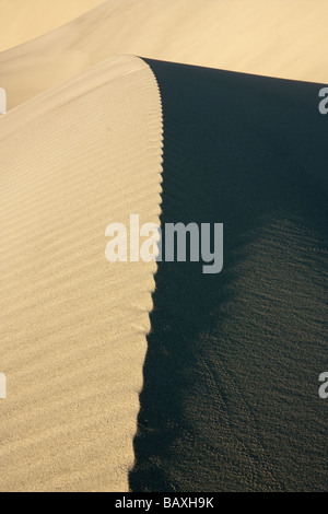 Morning light on sand dunes among the Eureka dunes, Death Valley National Park, CA - Stock Photo