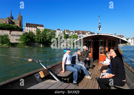 Passenger Ferry with cathedral, Basel Muenster in the background, Basel, Switzerland - Stock Photo