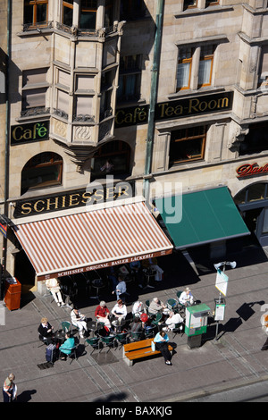 People sitting in a pavement cafe at Marktplatz, Basel, Switzerland - Stock Photo
