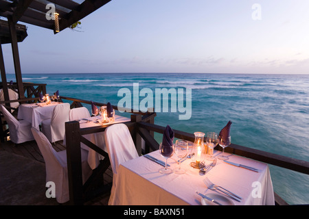 Terrace by the water's edge in the evening of the restaurant Josef's, St. Lawrence Gap, Barbados, Caribbean