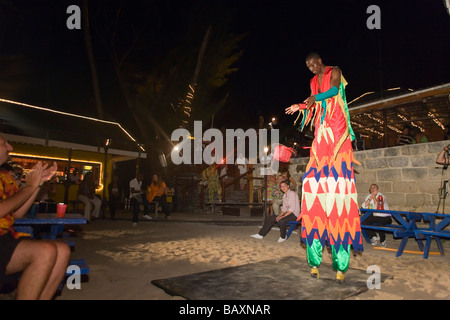 Stiltwalker, Dinner Show in Harbour Lights Club, Bridgetown, Barbados, Caribbean - Stock Photo