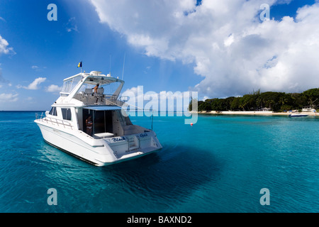 Yacht near in Sandy Lane Bay, Barbados, Caribbean - Stock Photo