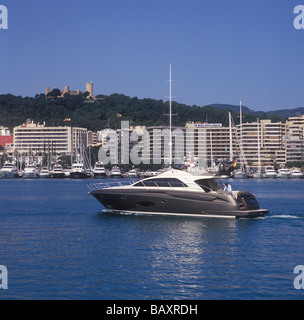 SportRiva 56 ( 17.57 mtrs) homeward bound  from Palma International Boat Show 2009 with historic Bellver Castle - Stock Photo