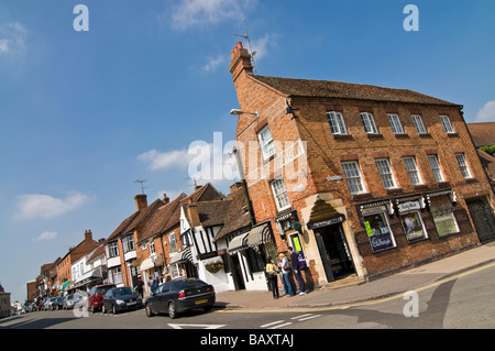 Horizontal wide angle of the different styles of period architecture along Sheep Street on a bright sunny day - Stock Photo