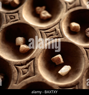 Detail of a wooden Mancala board game in Malawi - Stock Photo