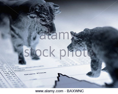 Bull and bear figurines on list of share prices - Stock Photo
