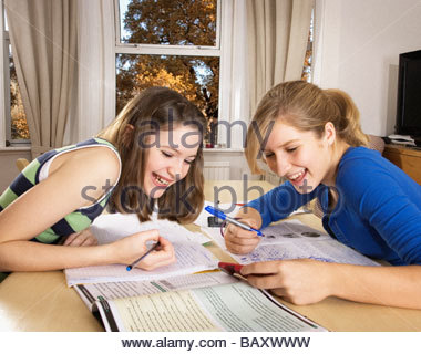 Girls looking at cell phone together - Stock Photo