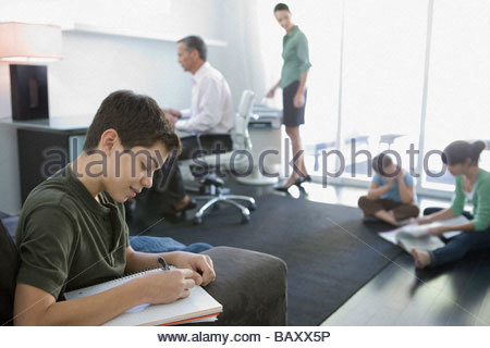 Family hanging out in home office - Stock Photo