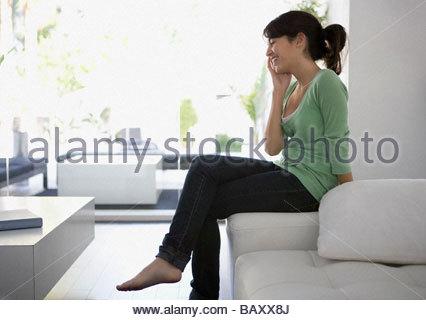 Teenage girl talking on cell phone - Stock Photo