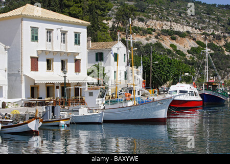 Boats moored in Gaios harbour in the sunlight, Ionian Islands, Paxos, Greece - Stock Photo