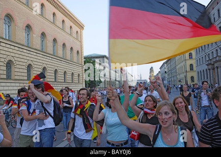 German soccer fans celebrating on Leopoldstrasse, Maxvorstadt, Munich, Bavaria, Germany - Stock Photo