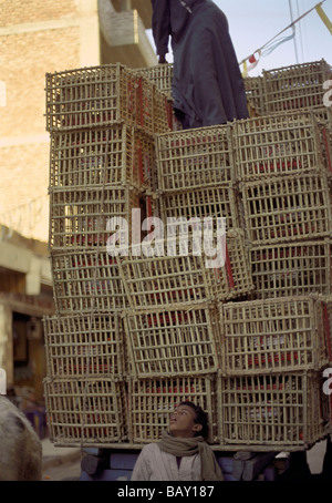A high pile of baskets, goods of a salesman, Luxor, Egypt - Stock Photo
