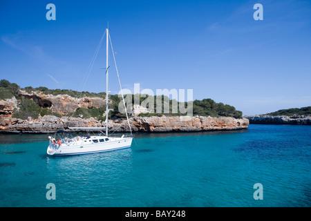 Sailboat at Cala sa Nau Cove, Cala sa Nau, Mallorca, Balearic Islands, Spain - Stock Photo
