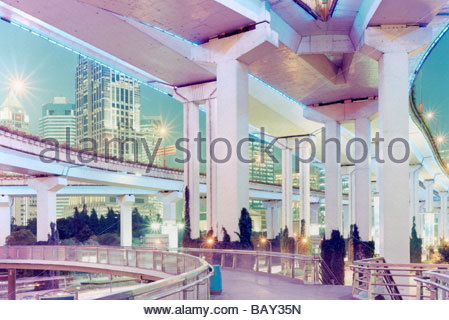 Elevated Expressway Yan`an Donglu with skyscrapers in the background, Shanghai, China - Stock Photo