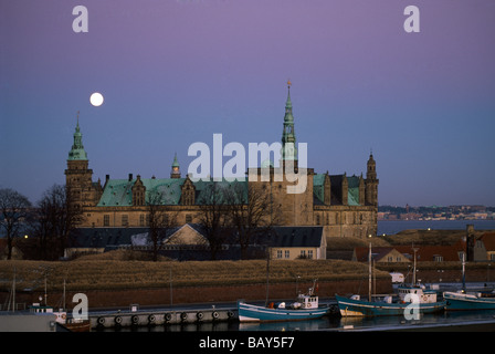 Renaissance castle Kronborg and harbour at night, Helsingor, Seeland, Denmark - Stock Photo