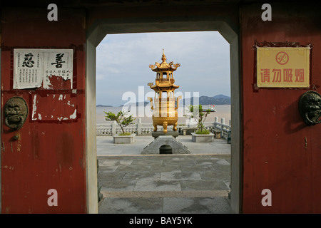Incense burner, South Heaven Gate Temple, Buddhist Island of Putuo Shan near Shanghai, Zhejiang Province, East China - Stock Photo