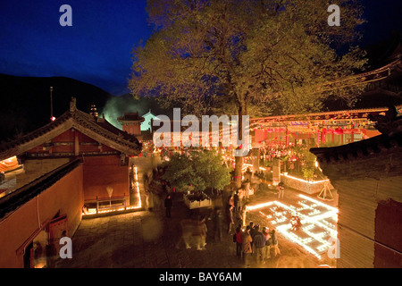 People lighting candles for the birthday celebrations for Wenshu, Shuxiang temple, Mount Wutai, Wutai Shan, Five - Stock Photo
